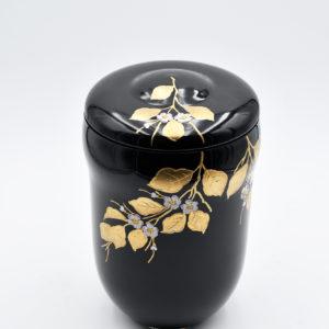 Pompes Funèbres Grosso : urne noire en verre avec des feuilles d'or